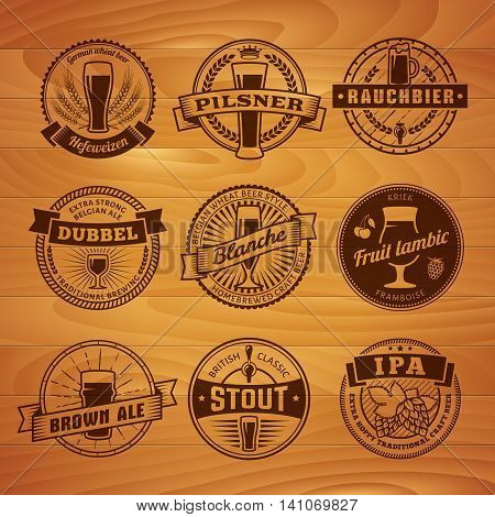 Craft beer labels. Traditional german, belgian and british beer styles. Weissbier, pilsner, rauchbier, dubbel, blanche, fruit lambic, brown ale, stout and IPA. Vintage craft beer emblems on a wooden background