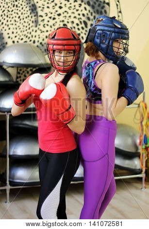 Portrait of sport girls boxing. In the gym.
