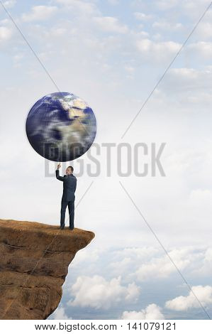 global business concept businessman spinning earth on one finger
