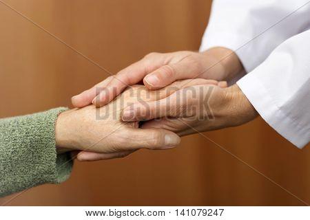 Women hand helping senior, patience assist help