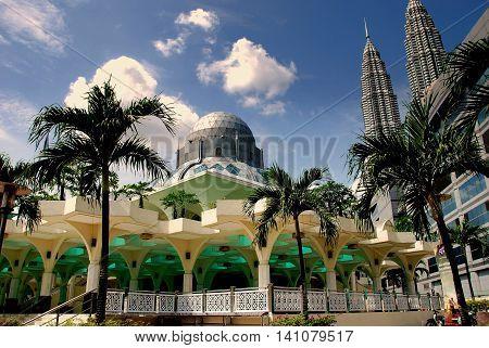Kuala Lumpur Malaysia - January 1 2008: Islamic Masjid Asy-Syakirin Mosque and the twin Petronas Towers *