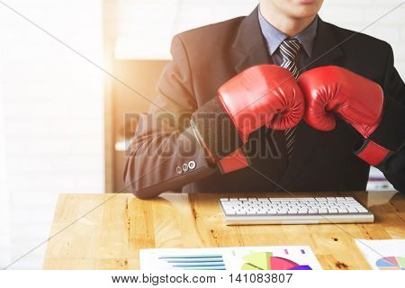 Businessman In Suit With Red Boxing Gloves