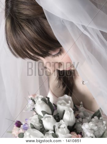 Bridal Portrait Looking Down At Bouquet