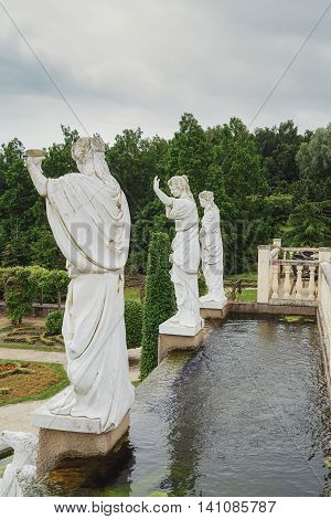 Landgraaf, Netherlands - July 12: Parc Mondo Verde, picture of a pond with on the side three Roman statutes, taken July 12, 2016 in Landgraaf, Netherlands.