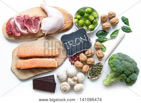 Foods rich in iron including meat fish pulses and seeds