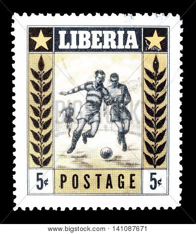 LIBERIA - CIRCA 1955 : Cancelled postage stamp printed by Liberia, that shows football players.
