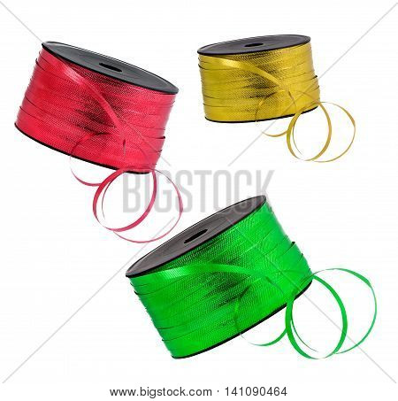 Gold, red and green ribbons on a spool