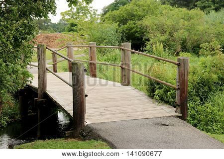 A wooden bridge covers the Carl's River in Babylon, NY