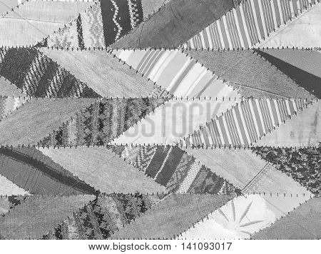 Closeup surface abstract fabric pattern at the gray fabric carpet at the floor of house textured background in black and white tone
