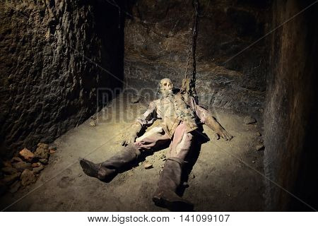 ZNOJMO, CZECH REPUBLIC - JULY 29, 2016: Lying human skeleton turtured in spooky dark historical underground under Znojmo. Underground comes from the 14-15 century and its corridors are long, almost 27 kilometers and have four floors.