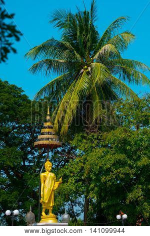 Respect Big Golden Buddha At The Temple In Thailand On Sunshine Day And Blue Sky