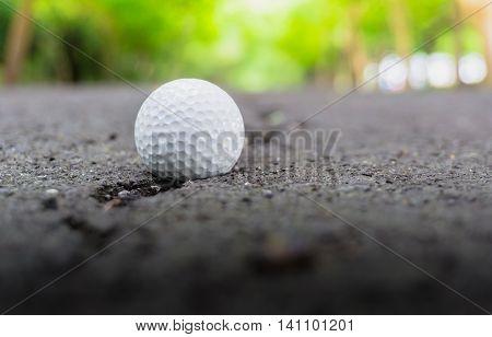 Golf ball on Lane Blacktop rough roads
