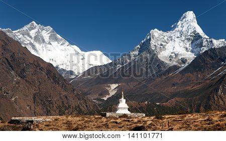 Ama Dablam and Lhotse with stupa on the way to mount Everest base camp - Nepal