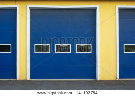 garage doors blue and yellow front of commercial building