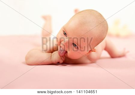 Portrait of adorable baby.Baby lying on his stomach