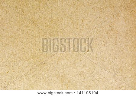 Old fibrous cardboard texture background, close up