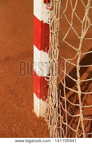 Detail Of Gate Frame . Outdoor Football Or Handball Playground, Light Red Clay