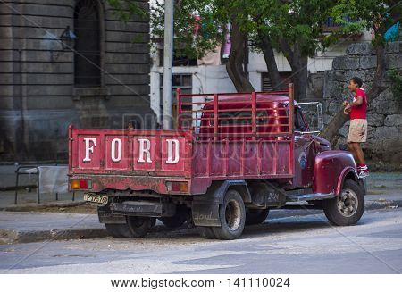 HAVANA CUBA - JULY 18 : Old classic American truck on one of Havana's streets on July 18 2016. There is nearly 60000 vintage American cars in Cuba