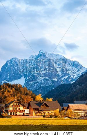 Beautiful landscape with village and snowed up mountains near Triglav national park in Slovenia. Traveling slovenian Alps