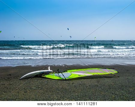 Tenerife, Canary Islands, Spain - December 22, 2008: Windsurfing board and sail at El Medano beach