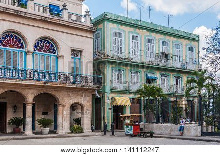HAVANA, CUBA - APRIL 1, 2016: Old colonial buildings in the Plaza de las Armas square of the Old Havana neighborhood in Cuba
