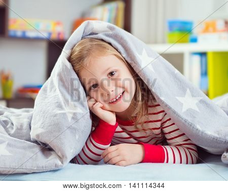 Pretty Little Girl Lying Under Blanket