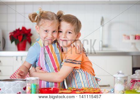 Cute Boy And Girl Preparing Christmas Cookies At Home