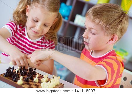 Two Cute Children Plaing Chess