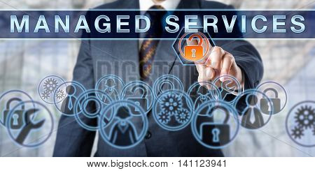 Corporate manager pushing MANAGED SERVICES on an interactive virtual screen. Business metaphor and information technology concept for outsourcing network security as part of enterprise IT strategy.