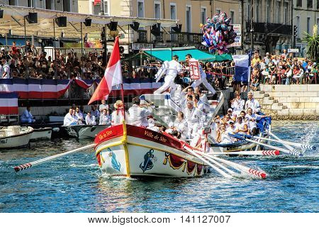 SETE, FRANCE - August 23 2014: Water Jousting performance during St.Louis festival at the streets of Sete South of France on August 23 2014. Saint Louis is the patronal feast of Sete and also the jousters holiday