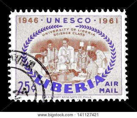 LIBERIA - CIRCA 1961 : Cancelled postage stamp printed by Liberia, that shows science class.