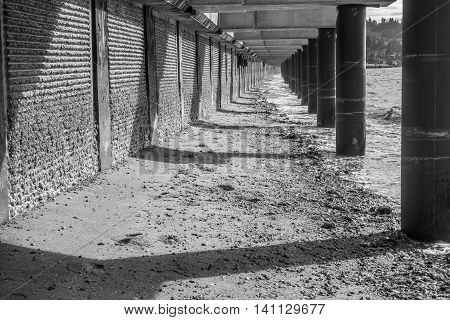 A view of a walkway that is under construction at Redondo Beach Washington. Black and white image.
