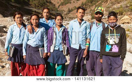 KOLTI VILLAGE WESTERN NEPAL 3rd DECEMBER 2013 - group of nepalese school young people near Kolti village in western Nepal
