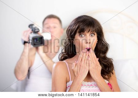 Couple With Video Camera In The Bedroom