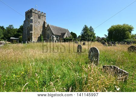 Typical country village church with overgrown graves
