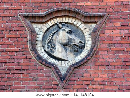 HELSINKI, FINLAND SEPTEMBER 25 2015: Horse detail on wall. Influenced by Classicism and modernised by Functionalism, Helsinki is also known for its Art Nouveau architecture.
