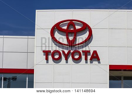 Muncie IN - Circa July 2016: A Local Toyota Car and SUV Dealership. Toyota is a Japanese Automaker Headquartered in Toyota Aichi Japan I