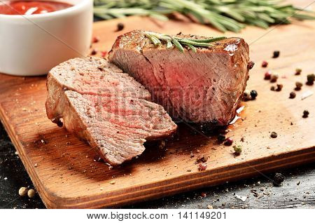 Prime Black Angus Filet mignon steak. Medium Rare degree of steak doneness.