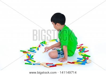 Happy asian child playing toy wood blocks isolated on white background. Educational toys for elementary child. Strengthen the imagination of child. Studio shot.