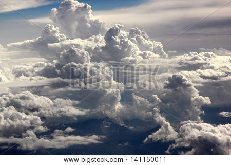 A view of clouds from a passenger jet window