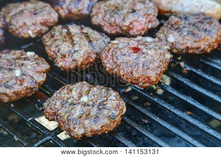 Hamburger and brats grilled and ready to eat