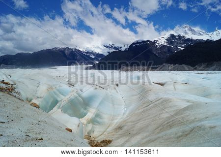 A landscape of the patagonia on a glaciar with mountains on the background