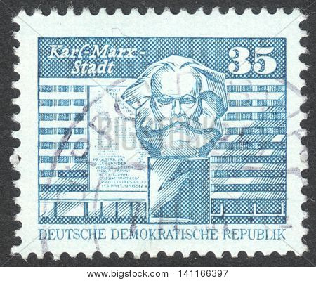MOSCOW RUSSIA - CIRCA APRIL 2016: a post stamp printed in DDR shows Karl-Marx-Monument in front of new buildings Chemnitz the series