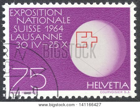 MOSCOW RUSSIA - CIRCA APRIL 2016: a post stamp printed in SWITZERLAND shows a globe with expo-badge dedicated to the Swiss National Exhibition Lausanne Switzerland circa 1963