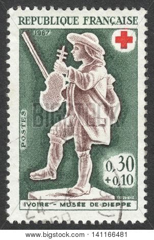 MOSCOW RUSSIA - CIRCA APRIL 2016: a post stamp printed in FRANCE shows a fiddler the series