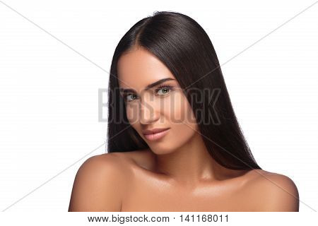 Pretty woman with long straight brown hair looking at camera isolated on white