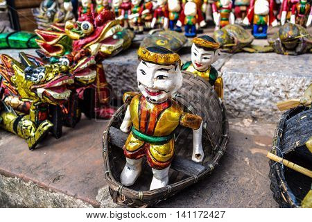 The Vietnamese traditional water puppets of the theater in Hanoi, Vietnam. Each puppet represents one character in the normal life in the past