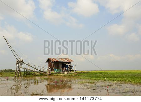 Square dip net and fisherman's home at Phattalung, Thailand, Landscape