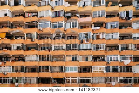 Texture of multistorey apartment house wall with balconies and windows in Palma de Mallorca