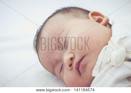 Closeup Cute Sleeping Baby. Adorable Baby Girl, On White Background. Vintage Tone.